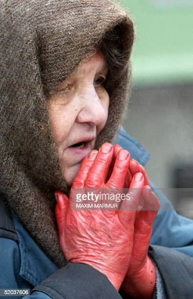 Russian Muslim prays with a ram's blood on her hands during a religion service marking the first day of the Moslim feast of Eid alAdha outside the...