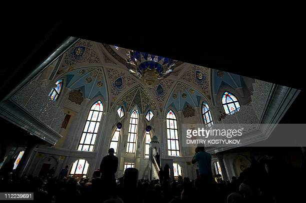 Russian Muslims pray during Friday noon prayers in the central Qol Sharif mosque in Kazan Tatarstan on April 15 2011 AFP PHOTO / DMITRY KOSTYUKOV