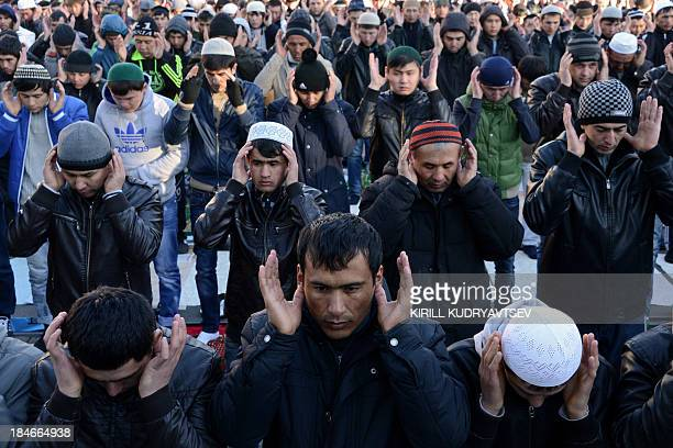 Russian Muslims pray outside Moscow's central mosque on October 15 during celebrations of Eid alAdha Muslims across the world are celebrating the...