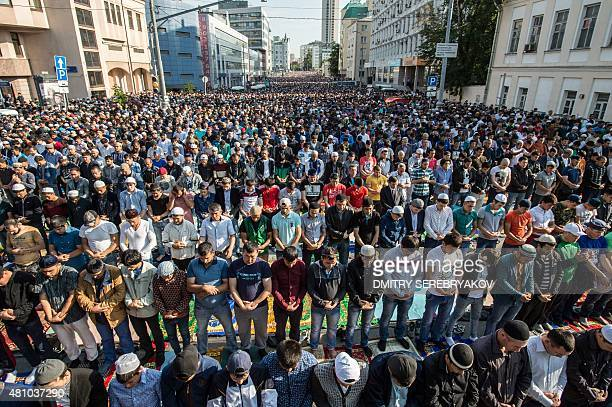 Russian Muslims pray outside the central mosque in Moscow on July 17 during celebrations of Eid alFitr marking the end of the fasting month of...