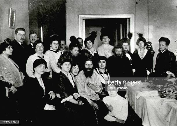Russian mystic Grigori Rasputin and his admirers in his flat on 64 Gorokhovaya street Saint Petersburg Russia circa 1915
