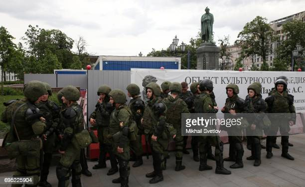 Russian National Guard troops stand in front of Pushkin Monunent during an unsanctioned anticorruption rally at Tverskaya street June 12 2017 in...