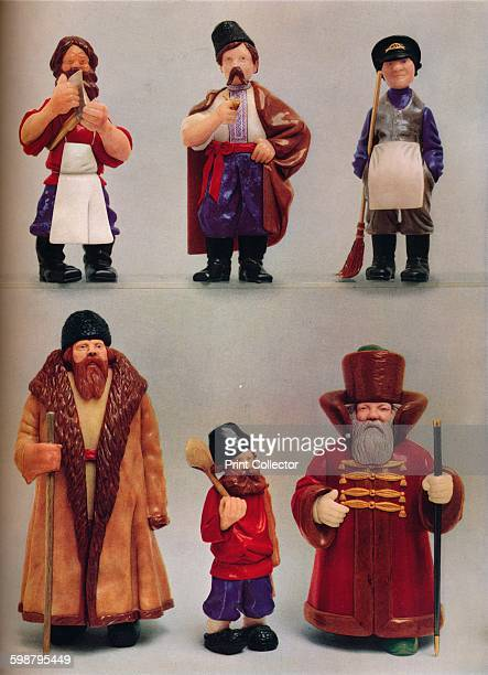 Russian National Types circa 1935 Russian national types fashioned in various tones Left to right top row Carpenter Peasant from Ukrane Houseman...
