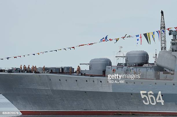 Russian Navy sailors are seen on the bow of the antisubmarine ship Admiral Tributs shortly after arriving at port in Manila on January 3 2017 The...