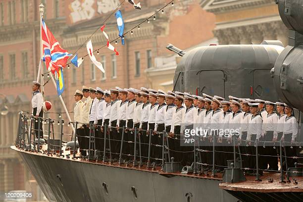 Russian Navy sailors stand on the deck of their ship during a Navy Day parade rehearsal on Neva River in St Petersburg on July 29 2011The celebration...