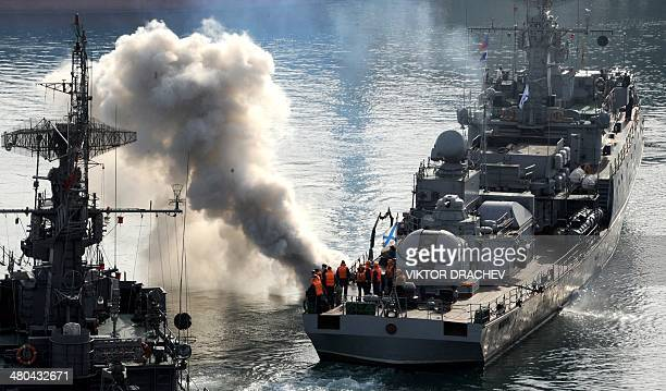 Russian navy sailors stand on the deck of their ship the 'Suzdalets' ASW corvette making its way in the bay of the Crimean city of Sevastopol on...