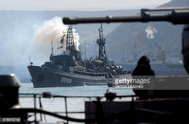 Russian Navy ship sails in front of Ukrainian Ternopil miltary ship on Sevastopol bay on March 18 2014 Ukraine's Westernbacked prime minister said on...
