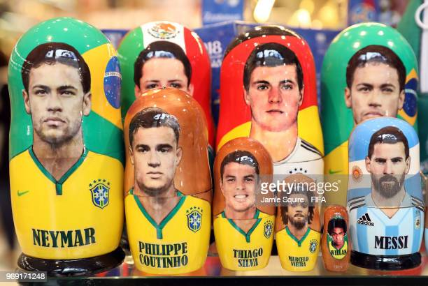 Russian nesting dools known as Matyroshka with depictions of World Cup atheletes are displayed in a store ahead of the 2018 FIFA World Cup on June 7...