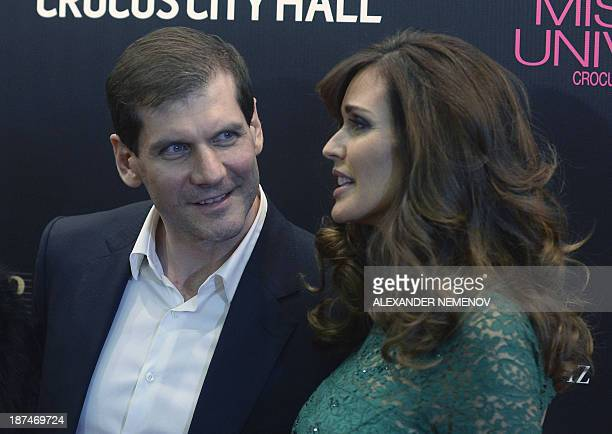 Russian NHL hockey star Alexey Yashin and his wife Fox News presenter and model Carol Alt pose along the red carpet before the 2013 Miss Universe...