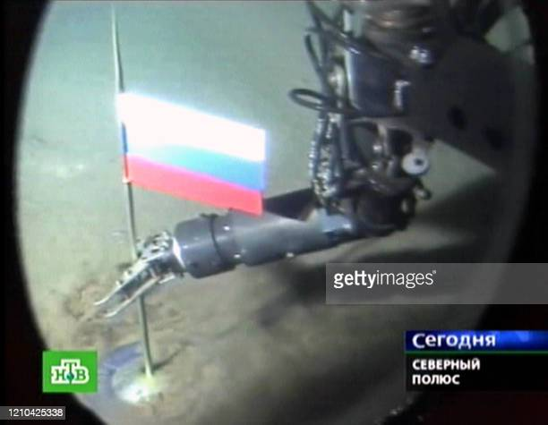 A Russian NTV channel grab taken 03 August 2007 shows a manipulator of the Mir1 minisubmarine as it places a Russian state flag at the seabed of...