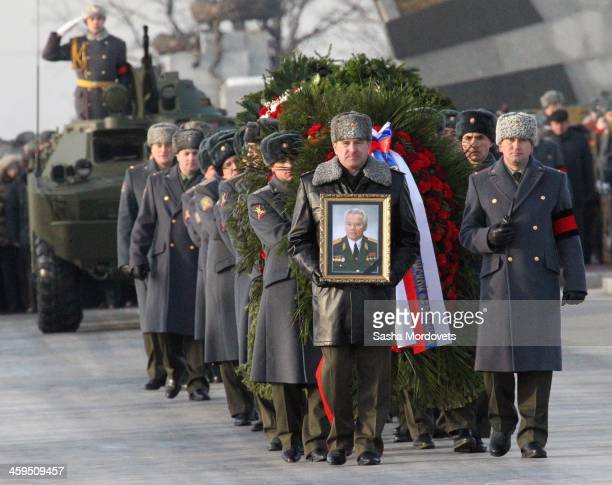 Russian officers carry a portrait of Mikhail Kalashnikov during his funeral ceremony at the Federal Military Memorial Cemetery December 27 2013 in...