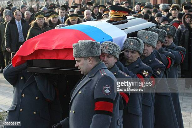Russian officers carry the coffin of Mikhail Kalashnikov during his funeral ceremony at the Federal Military Memorial Cemetery December 27 2013 in...