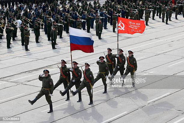 Russian officers with Soviet flag attend the Victory Day military parade rehearsals at Alabino polygon 40 km West of Moscow on April 2016 in Moscow...