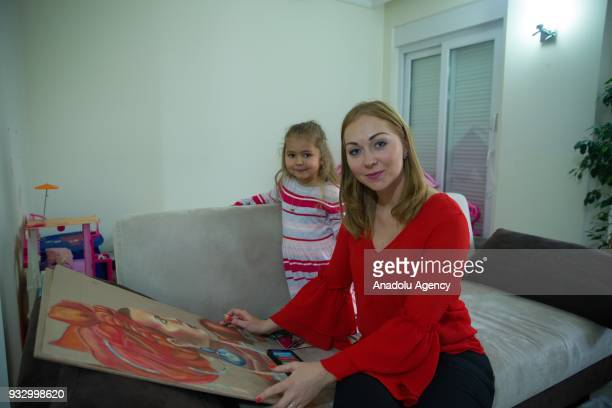 Russian Olga who is married to a Turkish man pose for a photo with her child Yasemin during an interview in Antalya Turkey on February 26 2018...