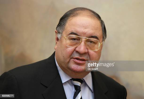 Russian Oligarch Alisher Usmanov is pictured in front of JMW Turner's painting ' The Harbour of Brest ' in the Tate Britain art gallery on November 7...