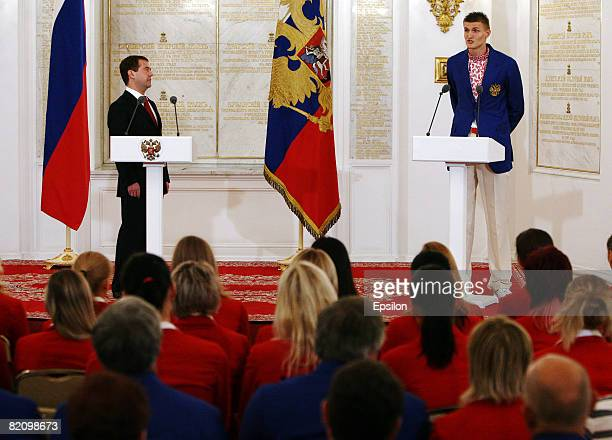 Russian Olympic basketball team player Andrei Kirilenko talks with Russian President Dmitry Medvedev during a wellwishing ceremony for the country's...