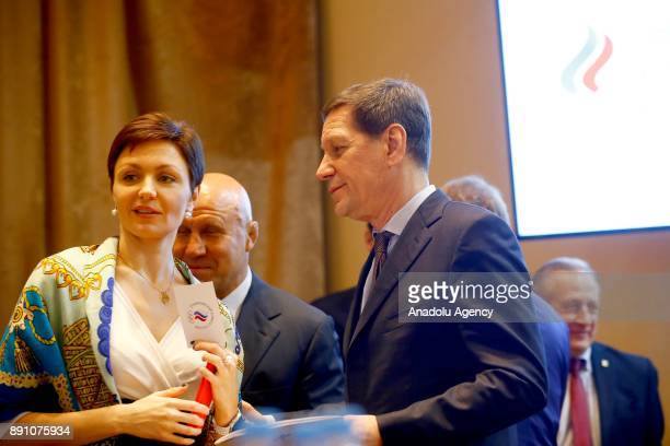 Russian Olympic Committee President Alexander Zhukov and fivetime Olympic synchronised swimming champion Anastasia Davydova attends at a session of...
