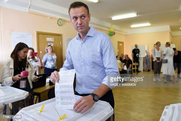Russian opposition activist Alexei Navalny casts his vote at a polling station during to the Moscow city Duma election in Moscow on September 8,...