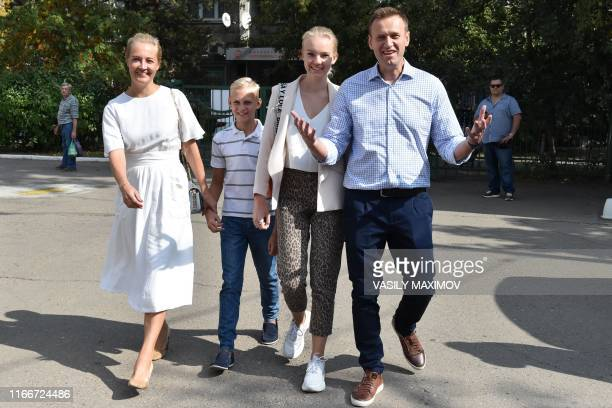 Russian opposition activist Alexei Navalny , his daughter Daria , son Zakhar and wife Yulia arrive at a polling station during to the Moscow city...