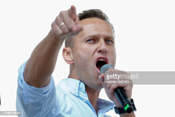 Russian opposition leader Alexei Navalny addresses demonstrators during a rally to support opposition and independent candidates after authorities...