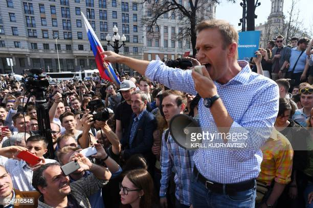 Russian opposition leader Alexei Navalny addresses supporters during an unauthorized anti-Putin rally on May 5, 2018 in Moscow, two days ahead of...