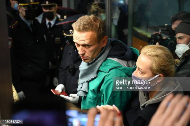 Russian opposition leader Alexei Navalny and his wife Yulia are seen at the passport control point at Moscow's Sheremetyevo airport on January 17,...