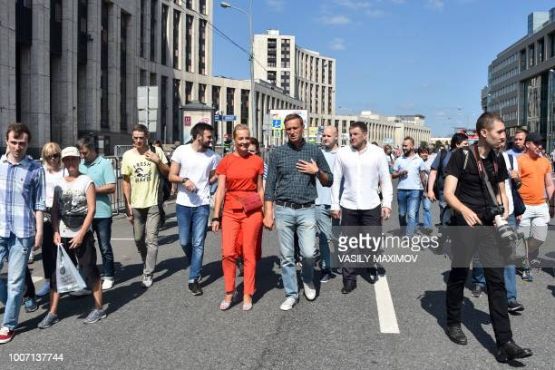 Russian opposition leader Alexei Navalny and his wife Yulia attend a rally against the government's proposed reform hiking the pension age in Moscow...
