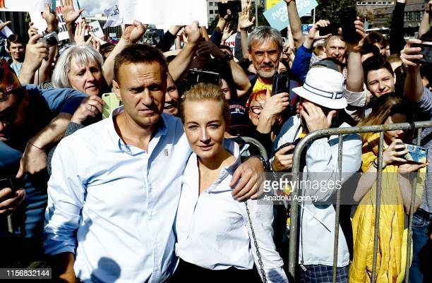Russian opposition leader Alexei Navalny and his wife Yulia attend a rally in support of opposition and independent candidates after authorities...