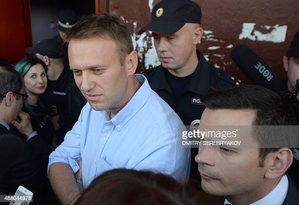 Russian opposition leader Alexei Navalny and RPR-Parnas opposition party candidate Ilya Yashin speak with people near the Open Russia movement during...