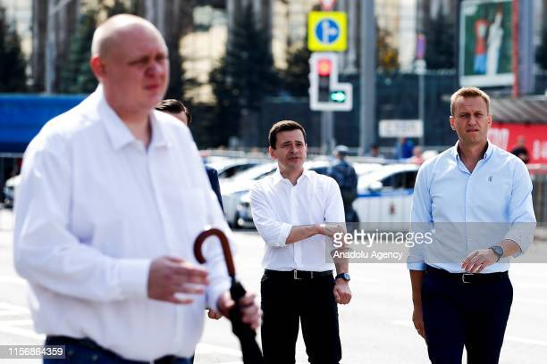 Russian opposition leader Alexei Navalny and Russian opposition activist Ilya Yashin attends a rally in support of opposition and independent...