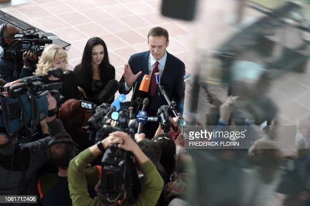 Russian opposition leader Alexei Navalny answers to journalists ahead of a hearing at the European Court of Human Rights in Strasbourg on November 15...
