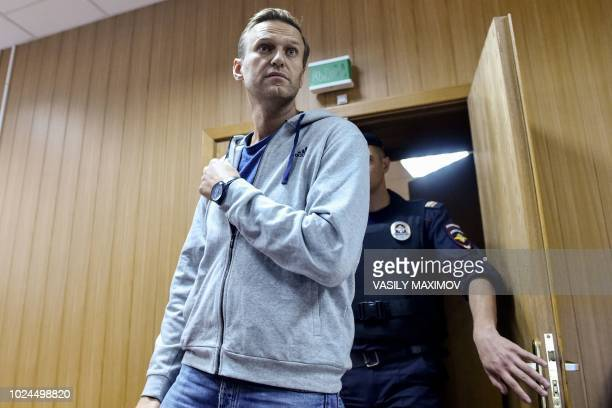 Russian opposition leader Alexei Navalny arrives for his trial at a Moscow courthouse on August 27 2018 A Moscow court on August 27 2018 gave a 30day...