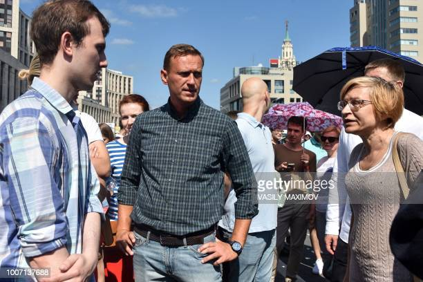 Russian opposition leader Alexei Navalny attends a rally against the government's proposed reform hiking the pension age in Moscow on July 29 2018...