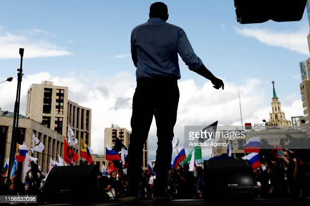 Russian opposition leader Alexei Navalny attends a rally in support of opposition and independent candidates after authorities refused to register...