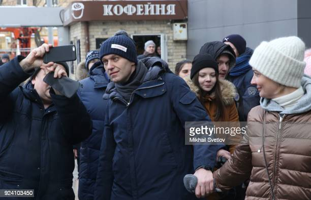 Russian opposition leader Alexei Navalny C and his wife Yulia Navalnaya pose for a photo after the Nemtsov March a rally in memory of Boris Nemstov...