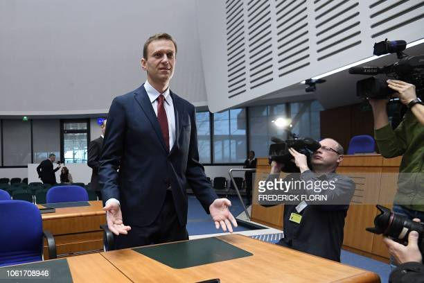 Russian opposition leader Alexei Navalny gestures ahead of a hearing at the European Court of Human Rights in Strasbourg on November 15 2018 Top...