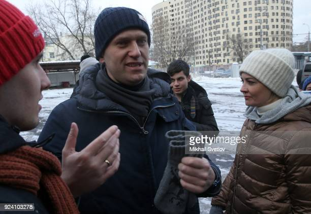 Russian opposition leader Alexei Navalny gestures as his wife Yulia Navalnaya looks on after the Nemtsov March a rally in memory of Boris Nemstov...