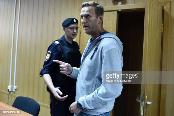 Russian opposition leader Alexei Navalny gestures during his trial at a Moscow courthouse on August 27 2018 A Moscow court on August 27 2018 gave a...