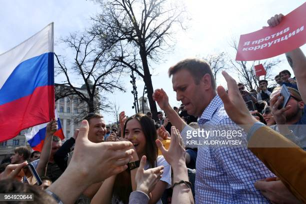 Russian opposition leader Alexei Navalny greets supporters during an unauthorized anti-Putin rally on May 5, 2018 in Moscow, two days ahead of...