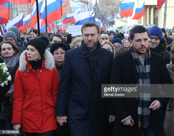 Russian opposition leader Alexei Navalny , his spouse ...