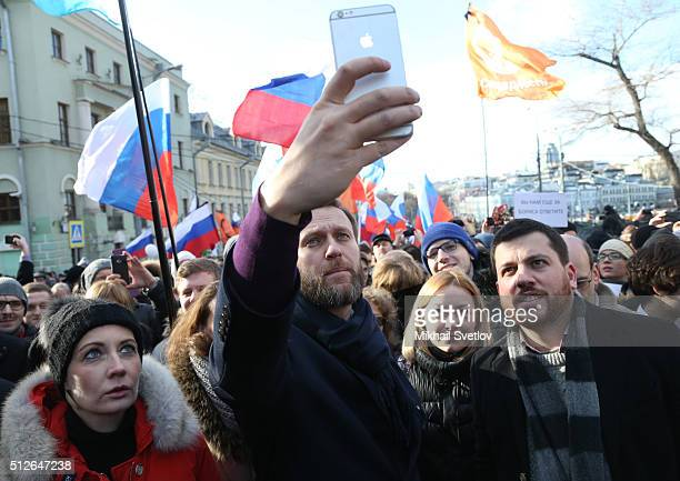 Russian opposition leader Alexei Navalny his spouse Yulia Navalnaya and his aide Leonid Volkov attend a mass march marking the oneyear anniversary of...