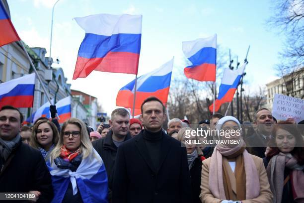 Russian opposition leader Alexei Navalny, his wife Yulia, opposition politician Lyubov Sobol and other demonstrators march in memory of murdered...