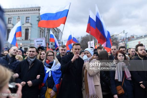 Russian opposition leader Alexei Navalny, his wife Yulia, opposition politician Lyubov Sobol and other demonstrators take part in a march in memory...