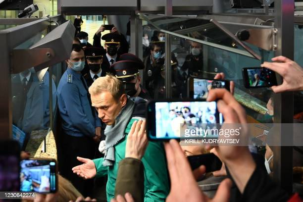 Russian opposition leader Alexei Navalny is seen at the passport control point at Moscow's Sheremetyevo airport on January 17, 2021. - Russian police...