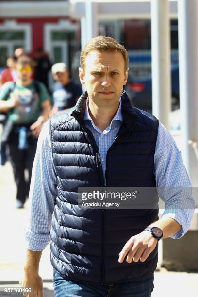 Russian opposition leader Alexei Navalny leaves from a court hearing in Moscow Russia on May 11 2018