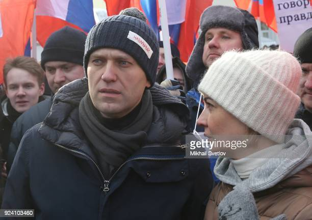 Russian opposition leader Alexei Navalny listens to his wife Yulia Navalnaya during the Nemtsov March a rally in memory of Boris Nemstov former First...