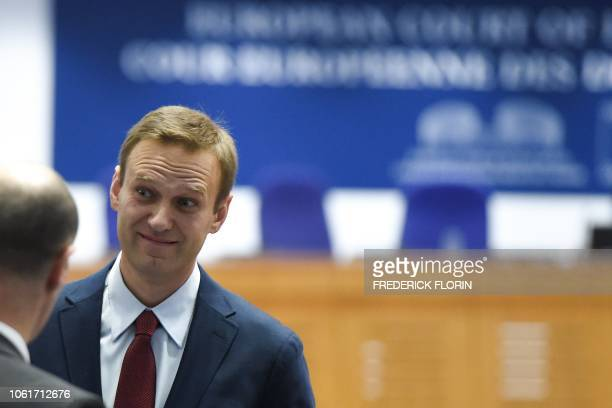 Russian opposition leader Alexei Navalny looks on ahead of a hearing at the European Court of Human Rights in Strasbourg on November 15 2018 Top...