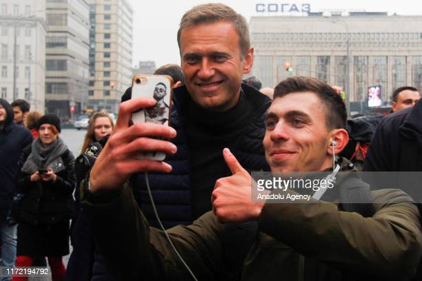 Russian opposition leader Alexei Navalny poses for a photo with participants as he attends a rally in support of political prisoners in Prospekt...