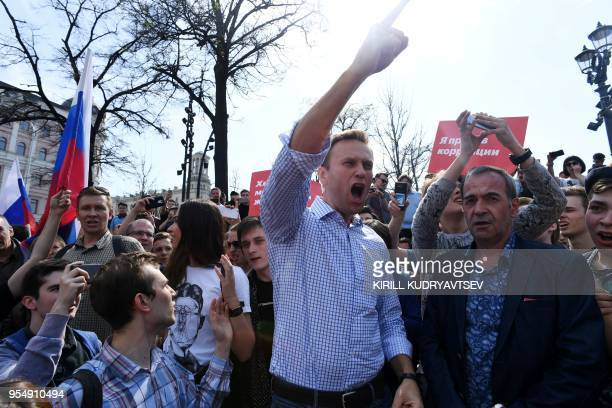 TOPSHOT Russian opposition leader Alexei Navalny shouts slogans during an unauthorized antiPutin rally on May 5 2018 in Moscow two days ahead of...