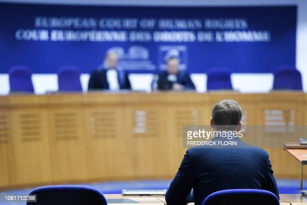 Russian opposition leader Alexei Navalny sits ahead of a hearing at the European Court of Human Rights in Strasbourg on November 15 2018 Top Kremlin...